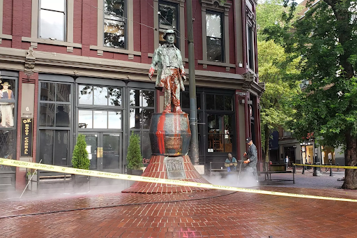 Workers clean the Gassy Jack monument following an anti-racist protest demanding its removal, June 2020. Courtesy CBC