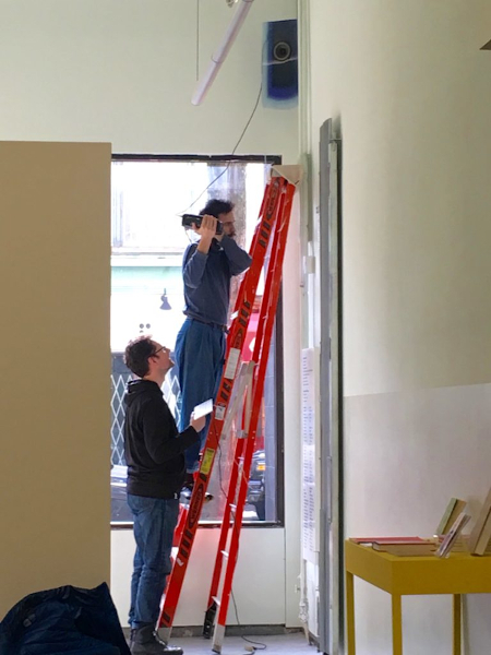 Jean Brazeau and Kamil Kisiel installing This Chime Has a Door (2018) at Pollyanna 圖書館 Library.
